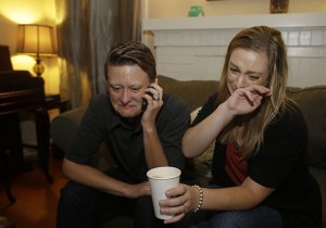 Lisa Kirk, left, and Lena Brancatelli react to the U.S. Supreme Court's ruling on gay marriage ERIC RISBERG / AP