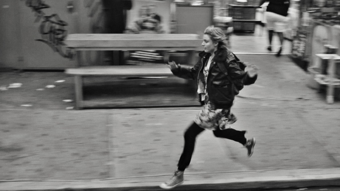 Frances running through the streets of Brooklyn