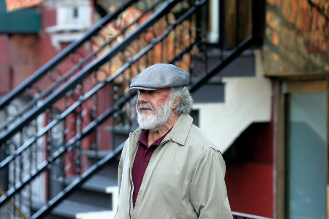 Actor Dustin Hoffman, wearing a beard and newsboy cap, films 'The Meyerowitz Stories' in East Village
